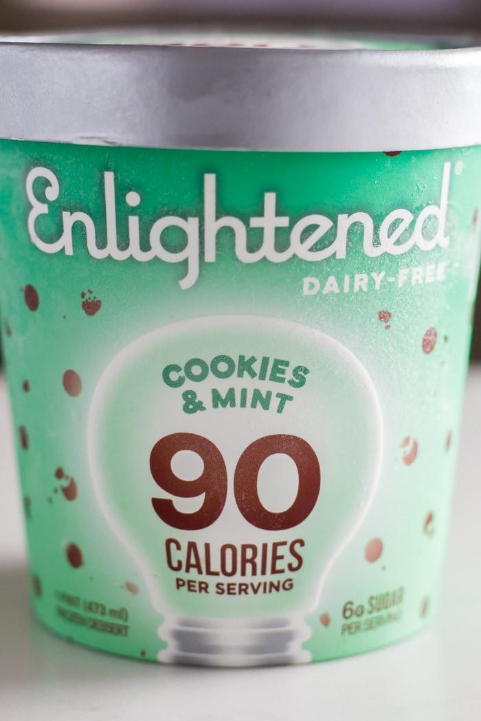 pint of Enlightened ice cream flavor cookies and mint