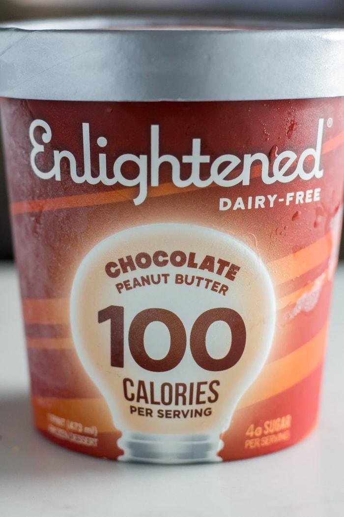 pint of Enlightened ice cream flavor chocolate peanut butter