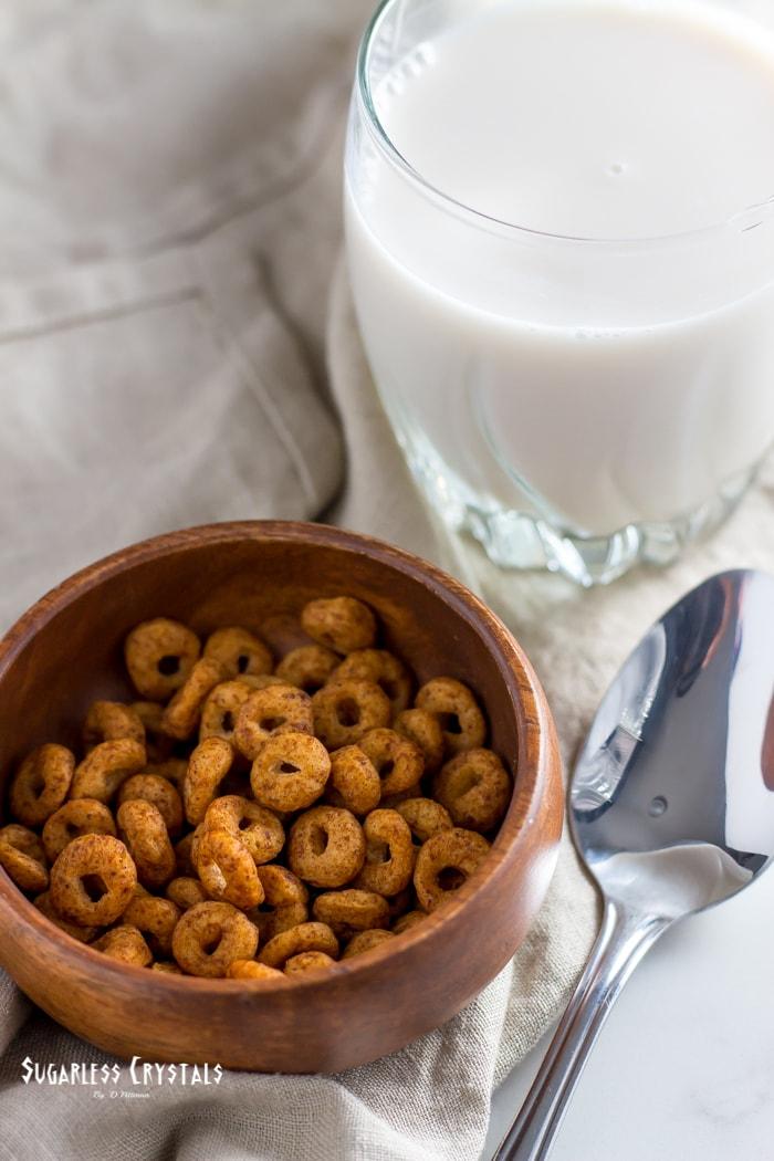 the cereal school flavor cinnamon bun with glass of almond milk