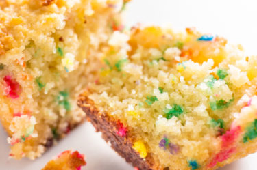 vanilla keto birthday cake split with sprinkles