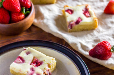 cheesecake keto blondies with strawberries sliced into squares