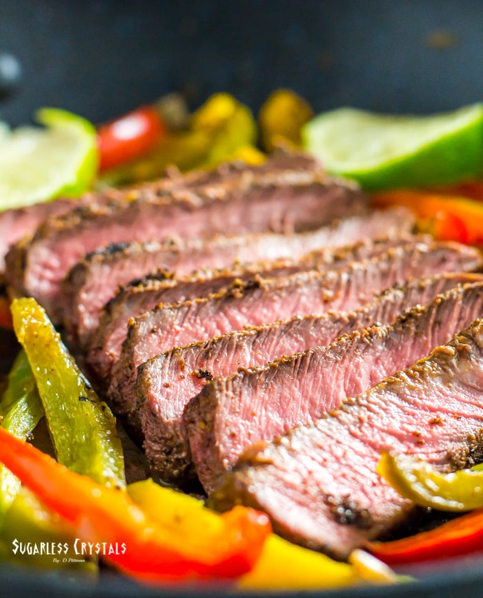 healthy steak fajitas in a pan with bell peppers