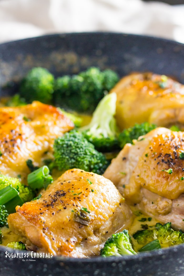 close view of a pan of low carb chicken and broccoli