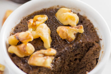 Keto Chocolate Mug Cake with Walnuts & Caramel with chunk taken out