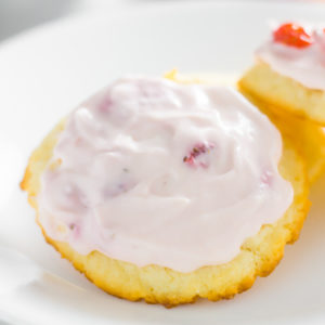 Cream cheese cookies with a strawberries and cream icing