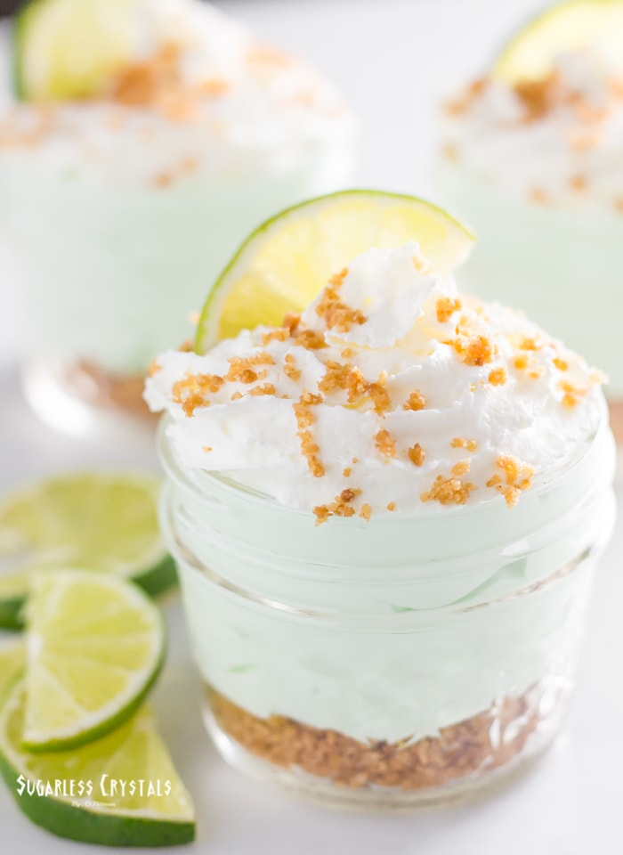 Key lime keto cheesecake no bake with whip cream and lime pieces