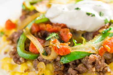 Mexican-style breakfast scramble with green peppers, sour cream and tomatoes