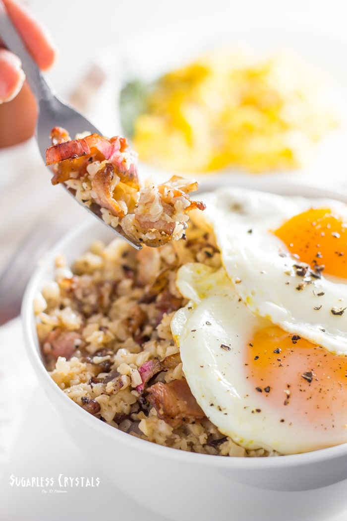keto bacon and egg breakfast bowl showing cauliflower rice and onion
