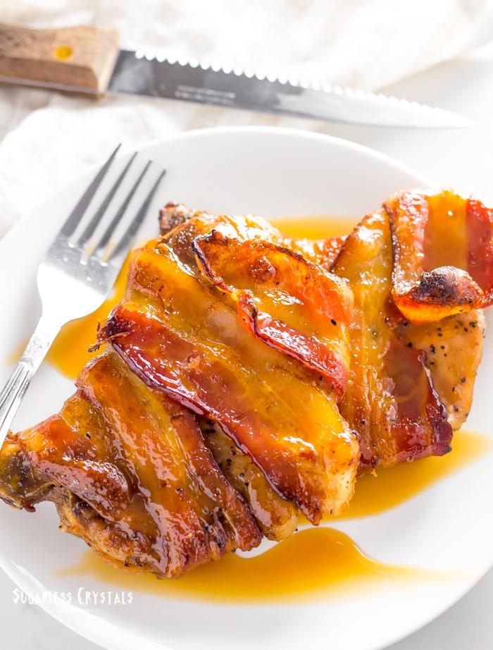 bacon wrapped pork chops covered in keto caramel glaze