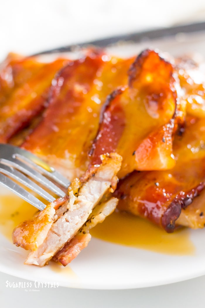 pork cops with caramel glaze cut piece on fork