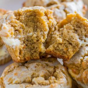 maple cream cheese keto pumpkin muffins split in half