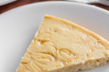 maple keto cheesecake with fork on plate