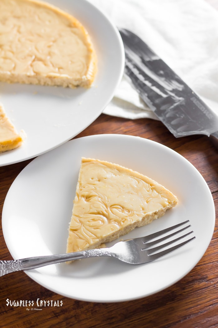 maple keto cheesecake sliced on a plate