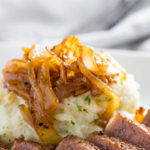 mashed cauliflower recipe topped with onions