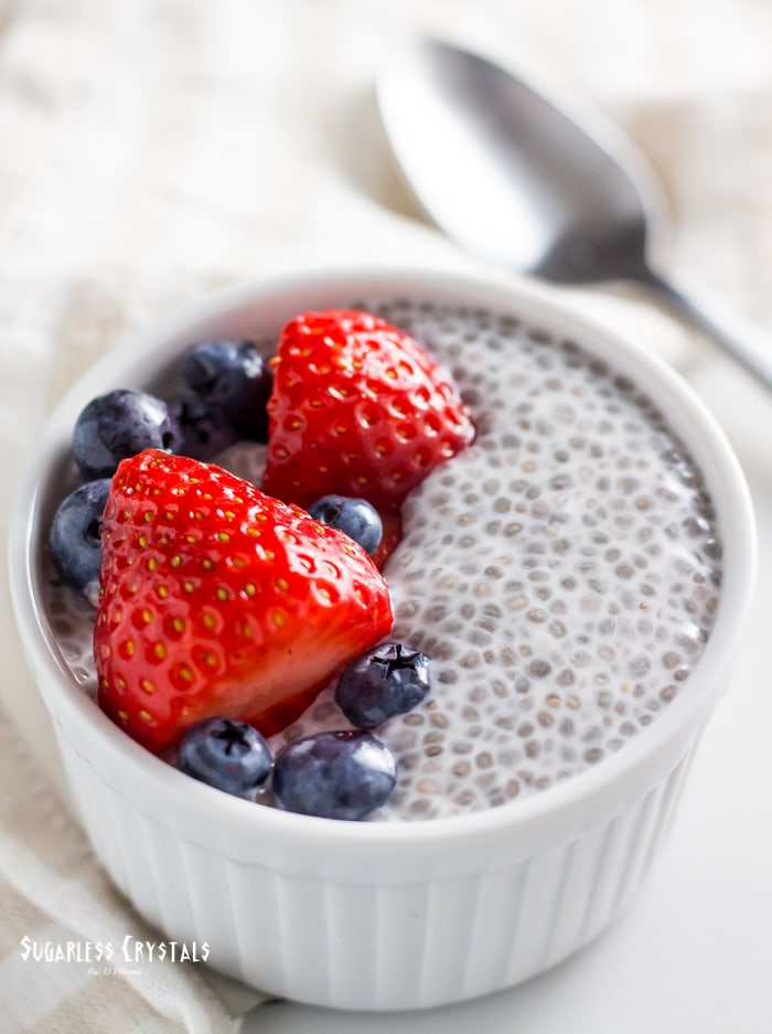 keto chia pudding with berries and a spoon