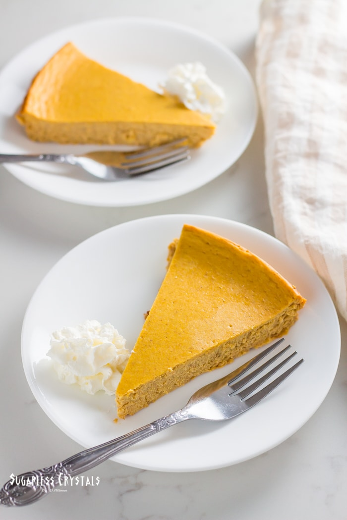 two slices of pumpkin spice keto cheesecake a plate
