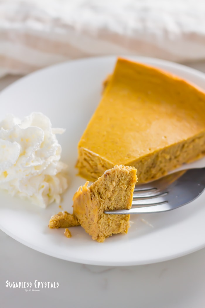 Pumpkin spice keto cheesecake with fork taking a piece