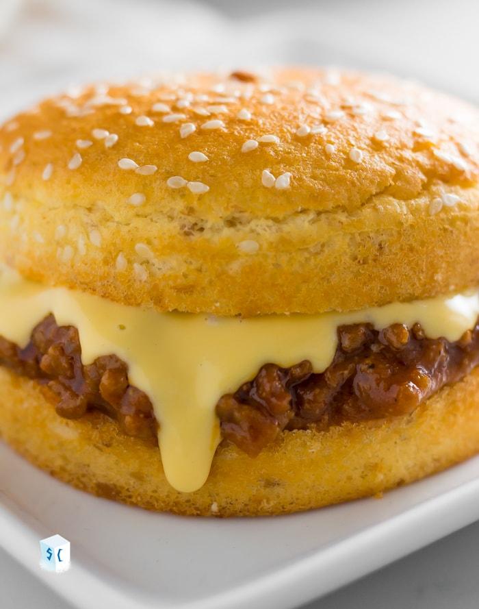 keto sloppy joes with keto cheese sauce on bun