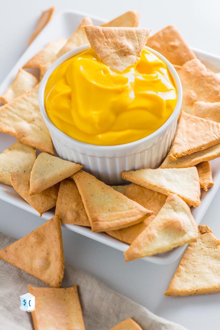 Keto tortilla chips with a bowl of keto cheese dip