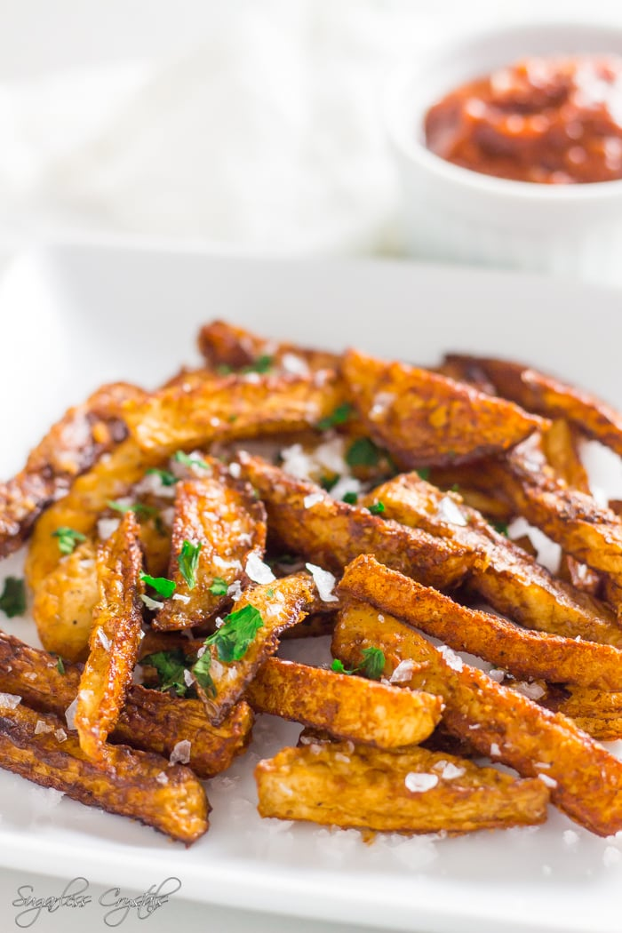 Keto fries on a plate with salt and garnish