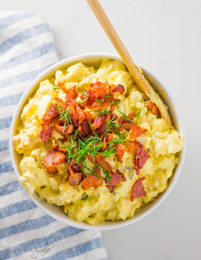 Keto egg salad topped with bacon