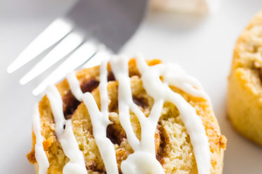 Keto cinnamon rolls with icing on plate
