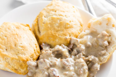 keto sausage gravy topped on a biscuit