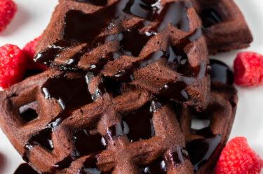 chocolate keto waffles with cream cheese and chocolate sauce