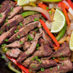 Keto Fajitas with steak, onion and bell pepper in cast iron